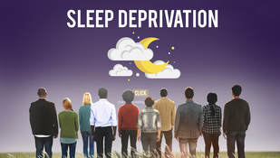 group of people looking at the words sleep deprivation