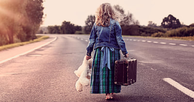little girl running away from home with suitcase and teddy bear